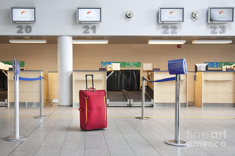 Abandoned Photograph - Luggage At An Airline Check-in Counter by Jaak Nilson