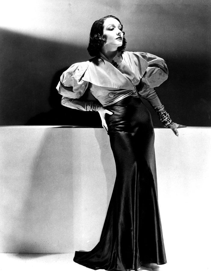 1930s Fashion Photograph - Lupe Velez Wearing Blue Satin Skirt by Everett