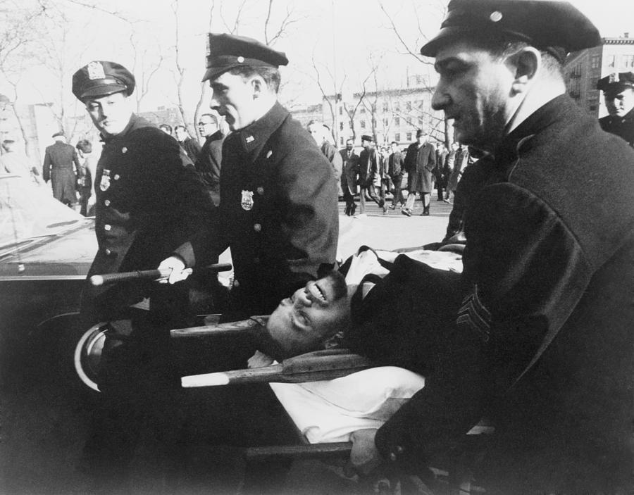 History Photograph - Malcolm X 1925-1965, On Stretcher by Everett