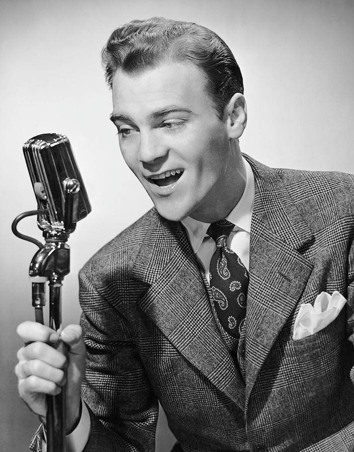 Adult Photograph - Male Singer Holding Microphone by George Marks