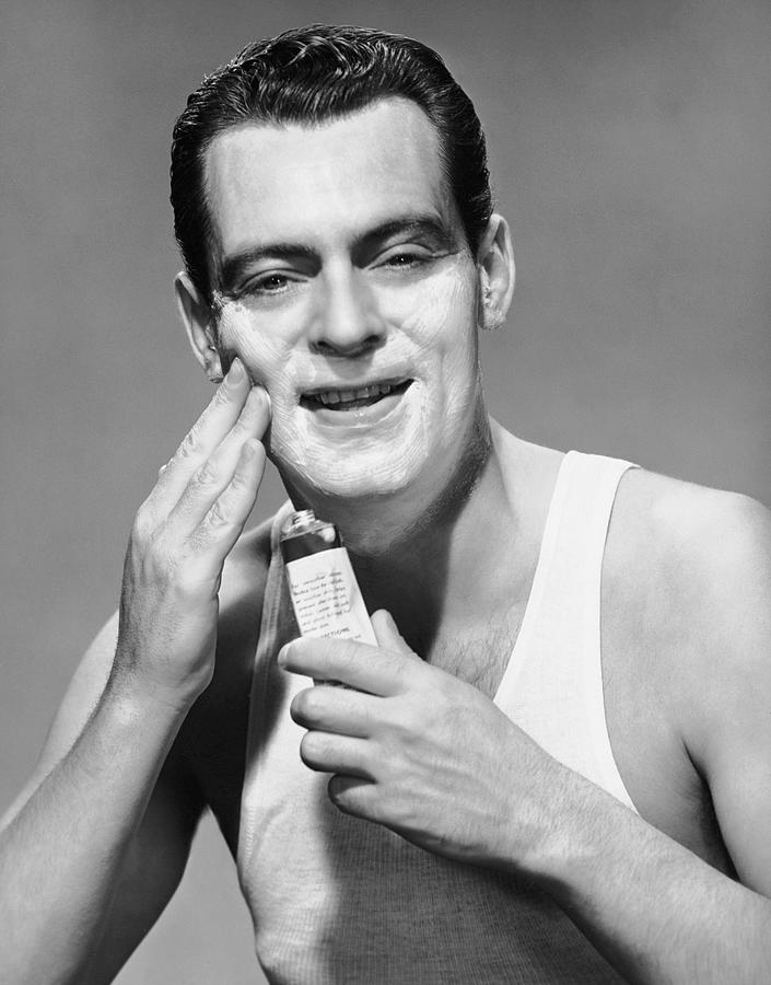 Adult Photograph - Man Applying Lotion by George Marks