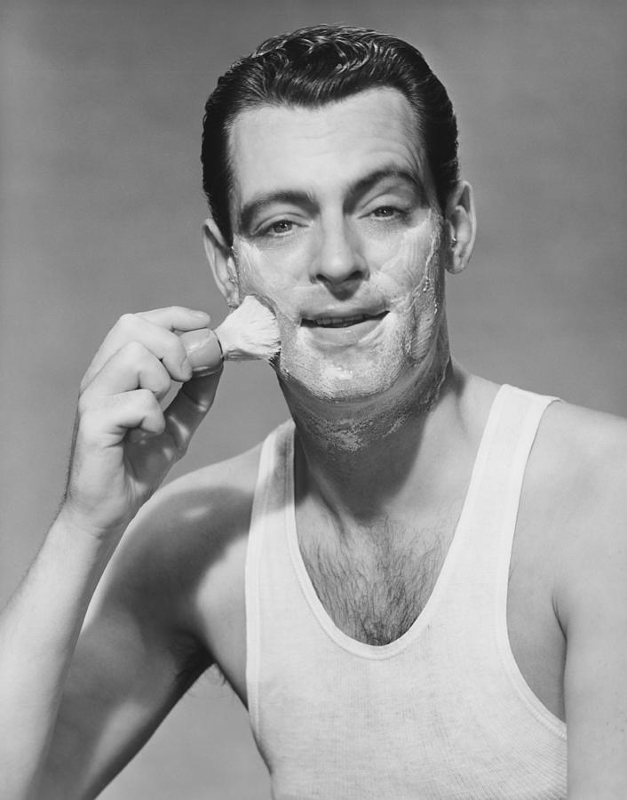 Adult Photograph - Man Applying Shave Foam On Face In Studio, (b&w), Portrait by George Marks
