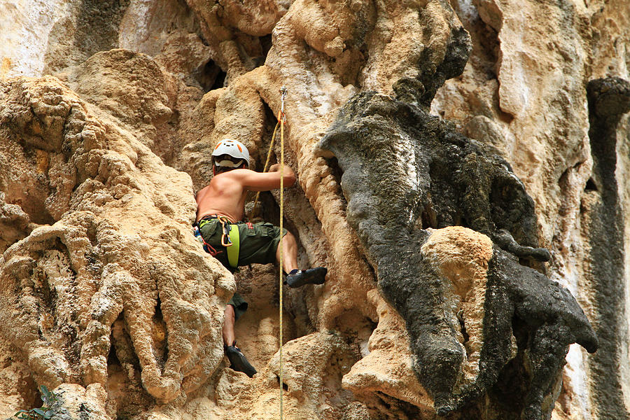 Adult Photograph - Man Climbing Rock by Ulrike Maier