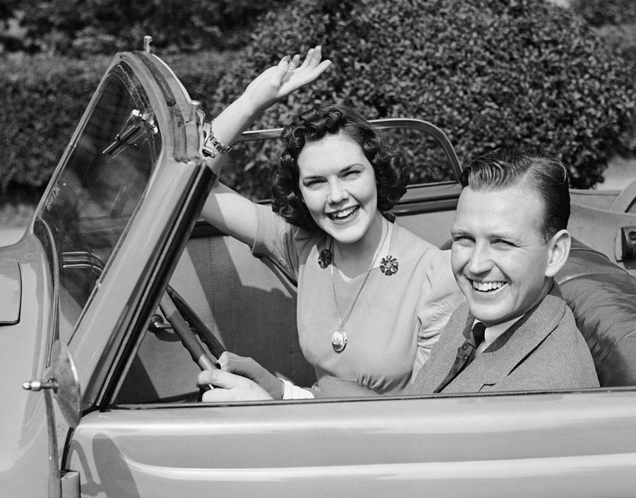 Adult Photograph - Man Driving Car And Woman Waving by George Marks