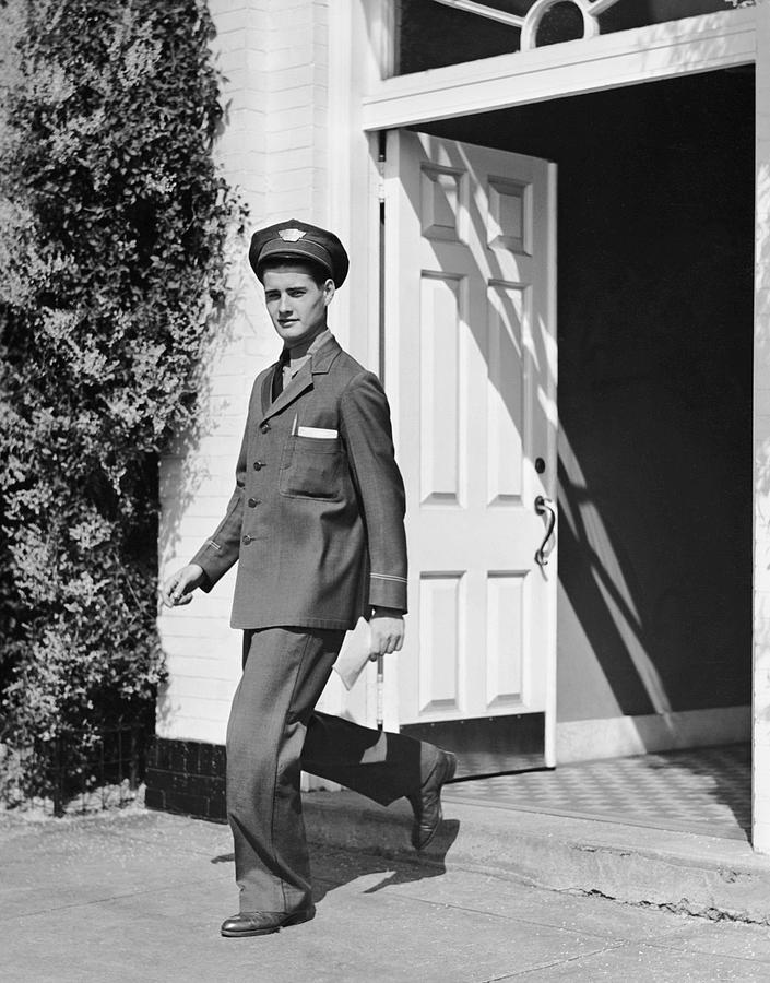 Adult Photograph - Man In Uniform Walking Out Door by George Marks