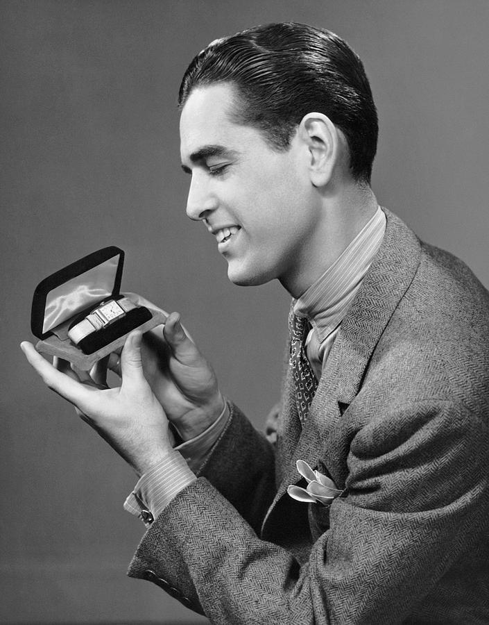 Adult Photograph - Man Looking At Watch In Box by George Marks
