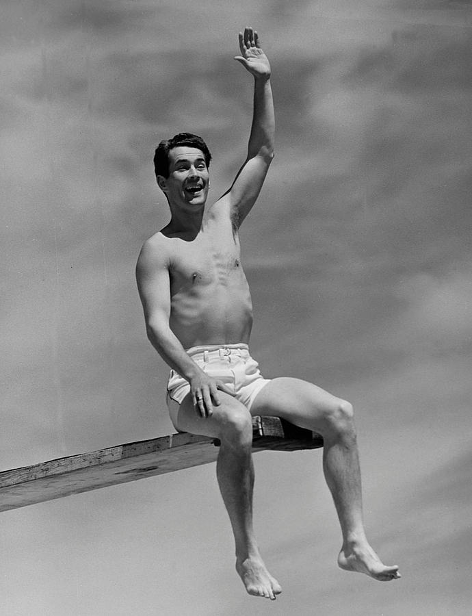 Adult Photograph - Man On Diving Board by George Marks