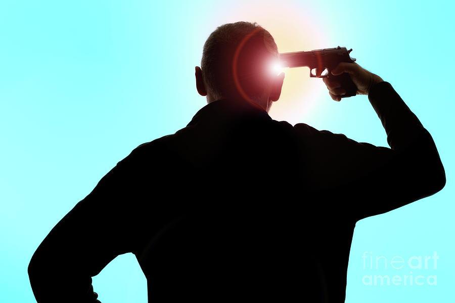 People Photograph - Man pointing gun on head  by Sami Sarkis