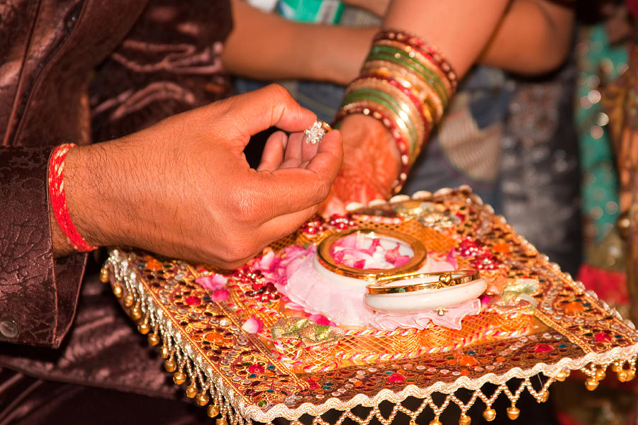 Man Putting A Gold Ring On The Henna Patterned Hand Of A Lady ...