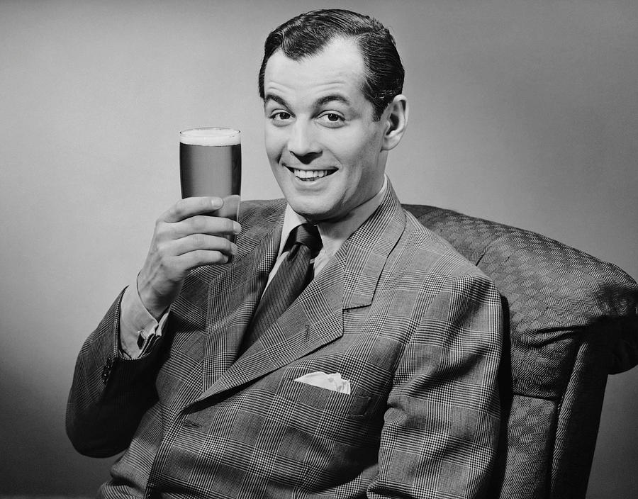 Adult Photograph - Man Sitting & Having A Beer by George Marks