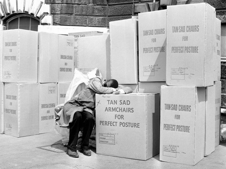 Horizontal Photograph - Man Sleeping On Box Outdoors (b&w) by Hulton Archive