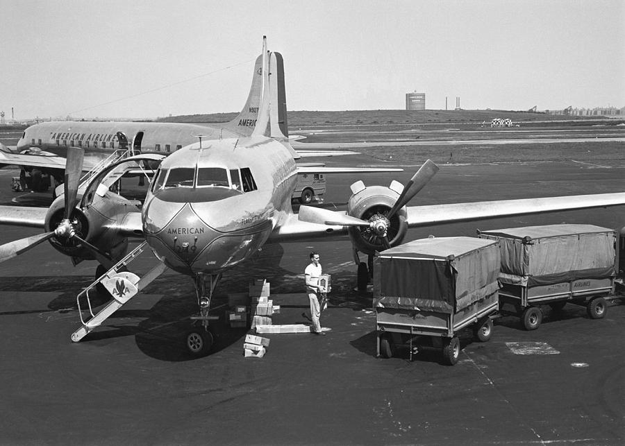 Adult Photograph - Man Standing At Airplane On Runway, (b&w) by George Marks