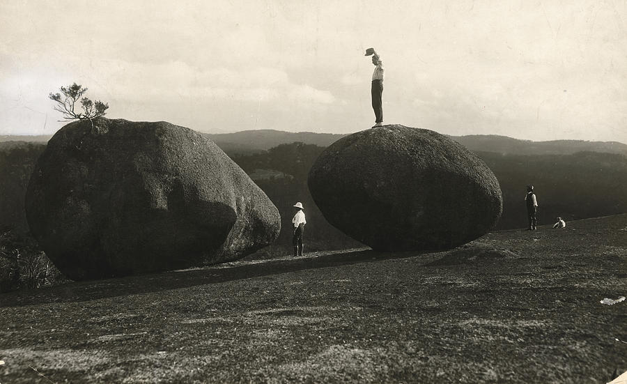Day Photograph - Man Stands Atop A Huge Boulder On Bald by Herbert E. Gregory