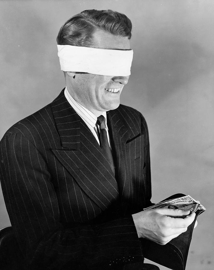 Mature Adult Photograph - Man Wearing Blindfold Holding Money (b&w) by Hulton Archive