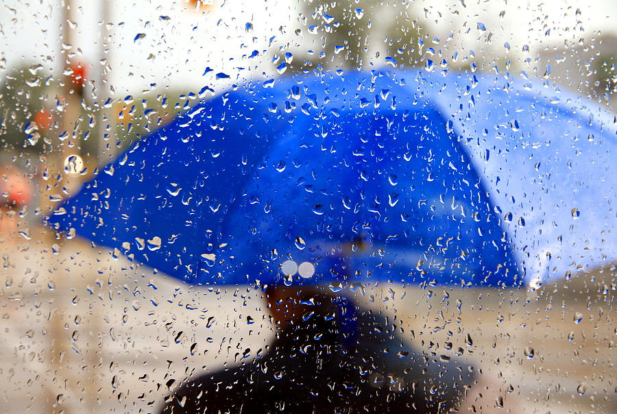 f78d9b457d406 Man With Blue Umbrella Photograph by Valentino Visentini