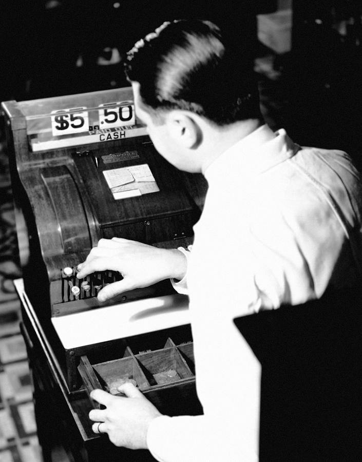 Adult Photograph - Man Working At Register by George Marks