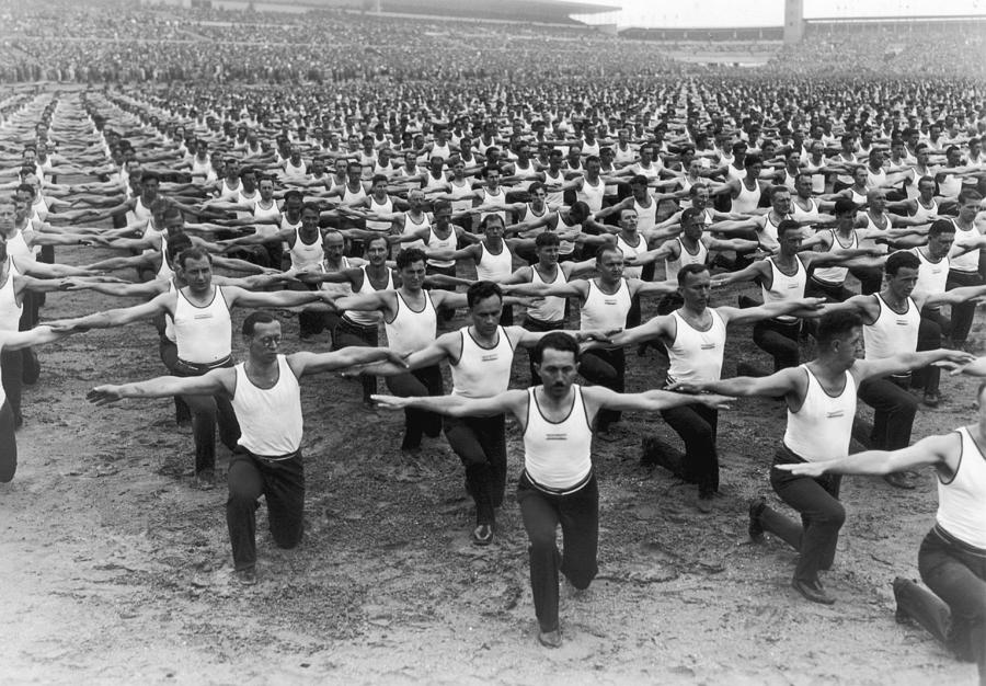 Horizontal Photograph - Mass Gymnastics by Archive Photos
