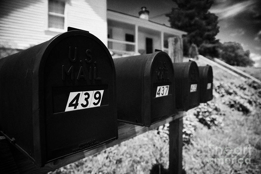 America Photograph - matt black american private mailboxes in front of houses Lynchburg tennessee usa by Joe Fox
