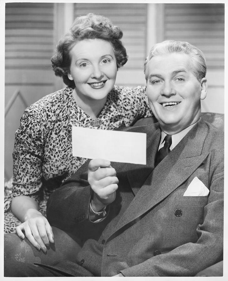 Adult Photograph - Mature Couple Posing, Man Holding Check, (b&w), Portrait by George Marks