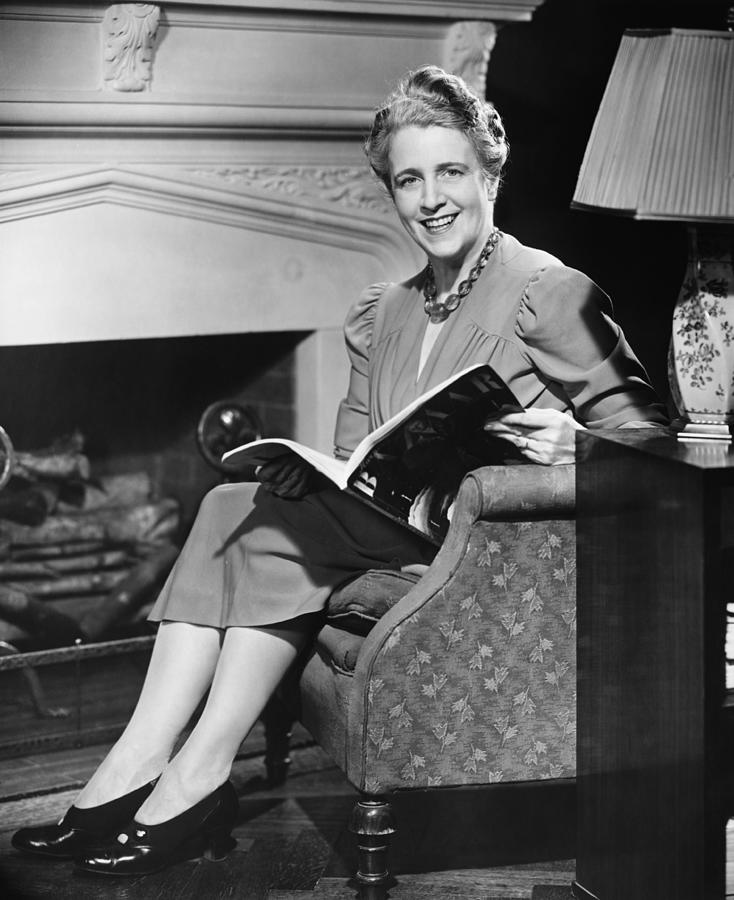 Adult Photograph - Mature Woman Sitting In Armchair, Holding Magazine, (b&w), Portrait by George Marks