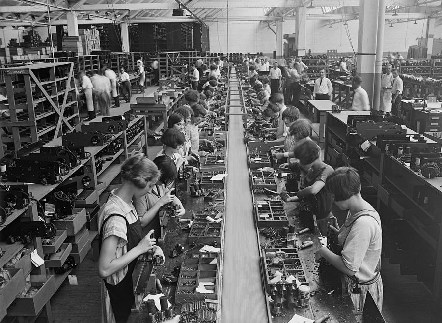 men and women working on a radio photograph by everett