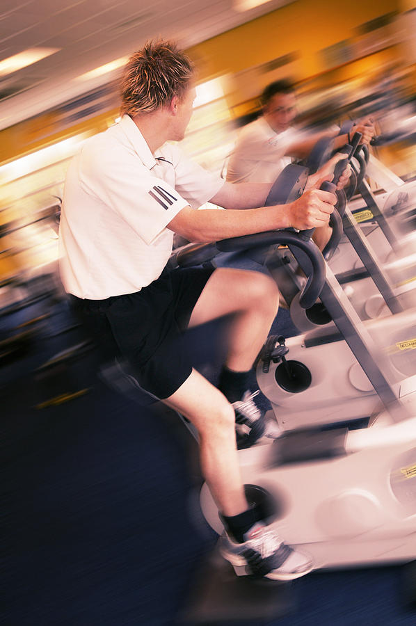 Exercise Bike Photograph - Men Exercising by Mark Sykes