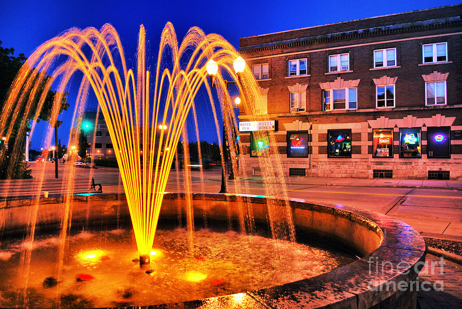 Menasha Photograph - Menasha Lighted Fountain by Ever-Curious Photography