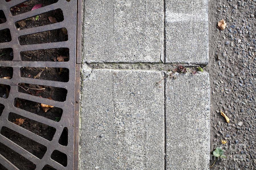 Close Up Photograph - Metal Grate On Sidewalk by Paul Edmondson