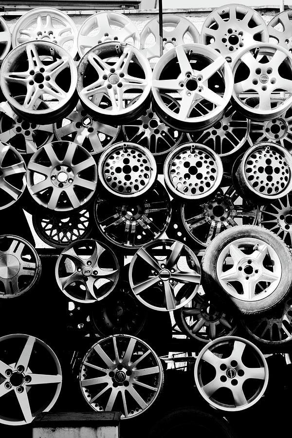Vertical Photograph - Metal Wheels by Ion-Bogdan DUMITRESCU