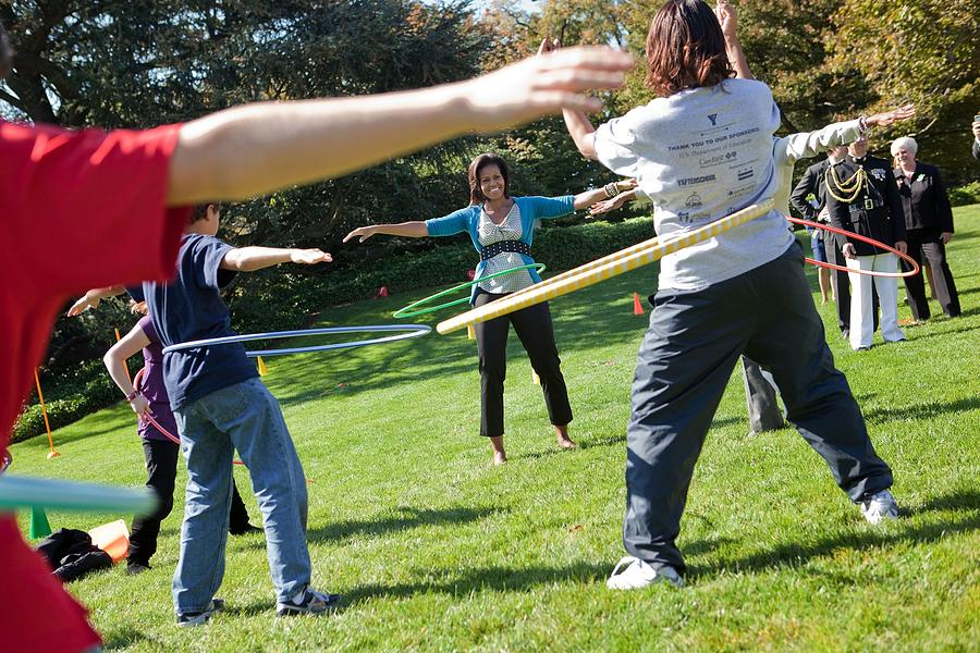 History Photograph - Michelle Obama Hula Hoops With Children by Everett