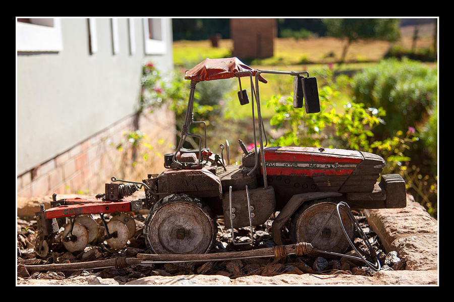 Farm Photograph - Model Tractor by Miguel Capelo