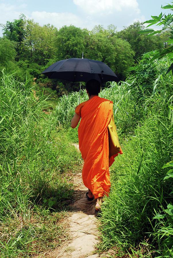 Adult Photograph - Monk Walking, Luang Prabang, Laos by Thepurpledoor
