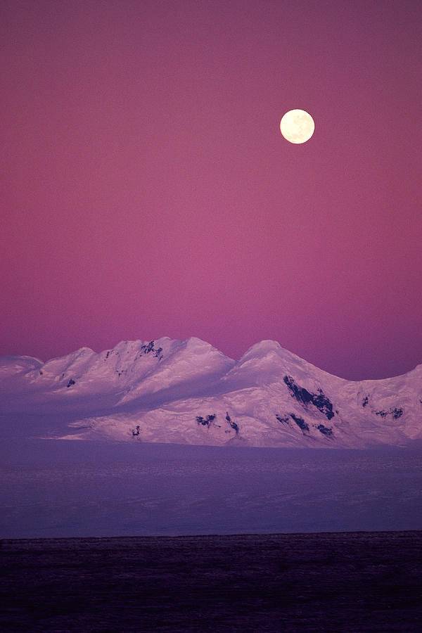 Vertical Photograph - Moonrise Over Snowy Mountain by Stockbyte