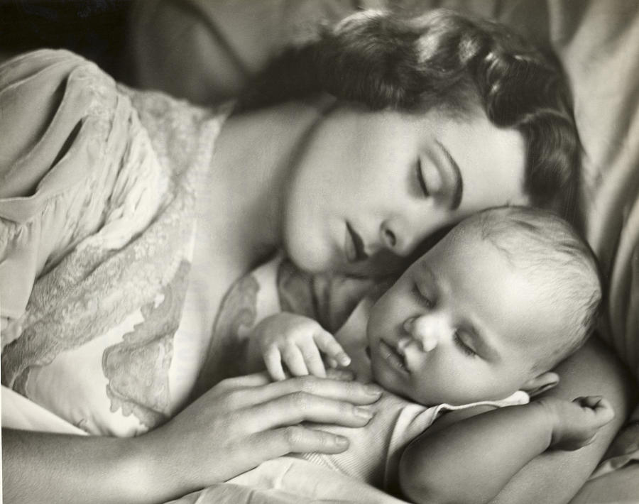Baby Photograph - Mother Holding Infant In Bed by George Marks