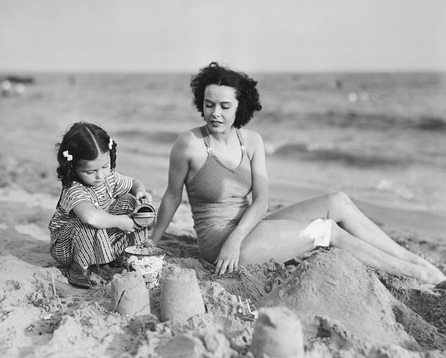 Child Photograph - Mother With Girl (2-3) Playing In Sand On Beach, (b&w) by George Marks
