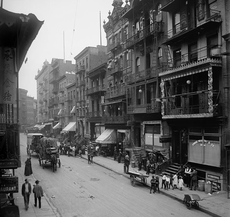 History Photograph - Mott Street In New York Citys Chinatown by Everett