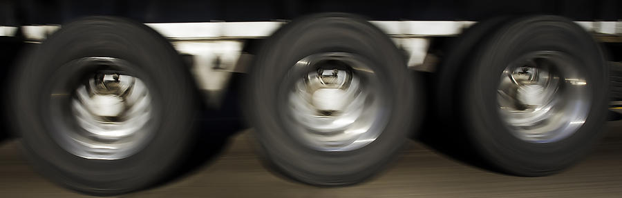 Tires Photograph - Moving Wheels by Miguel Capelo