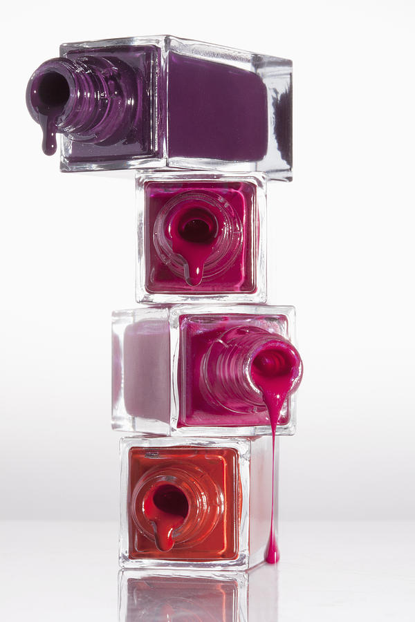 Nail Polish Dripping From A Stack Of Bottles Photograph by Larry ...