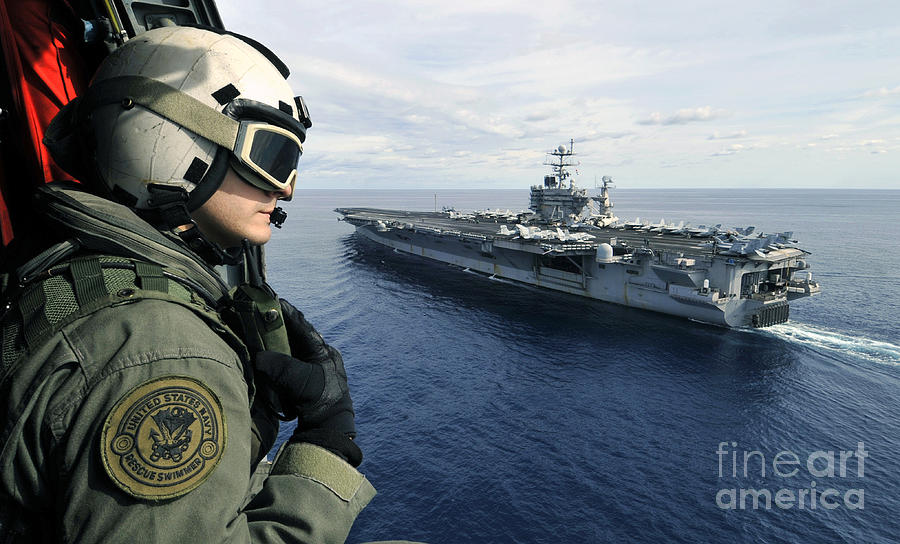 Aircraft Carrier Photograph - Naval Air Crewman Conducts A Visual by Stocktrek Images