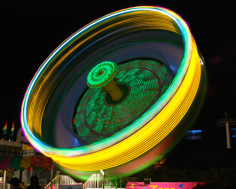 Amusement Park Ride Photograph - Neon Tilt A Whirl by Sonja Quintero