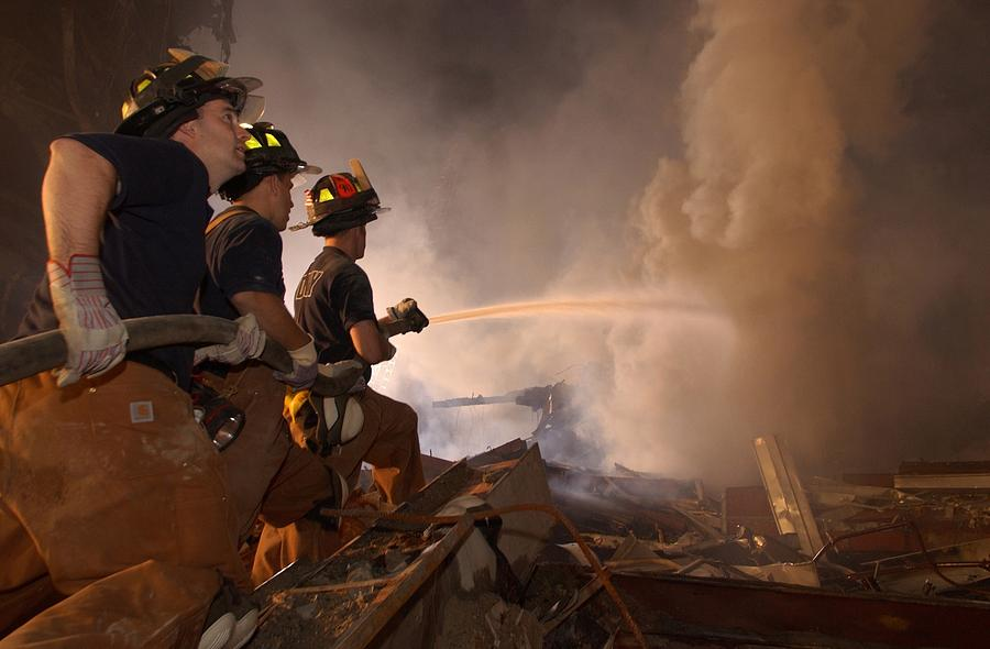2000s Photograph - New York Firefighters Continue by Everett