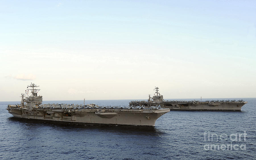 On The Move Photograph - Nimitz-class Aircraft Carriers Transit by Stocktrek Images