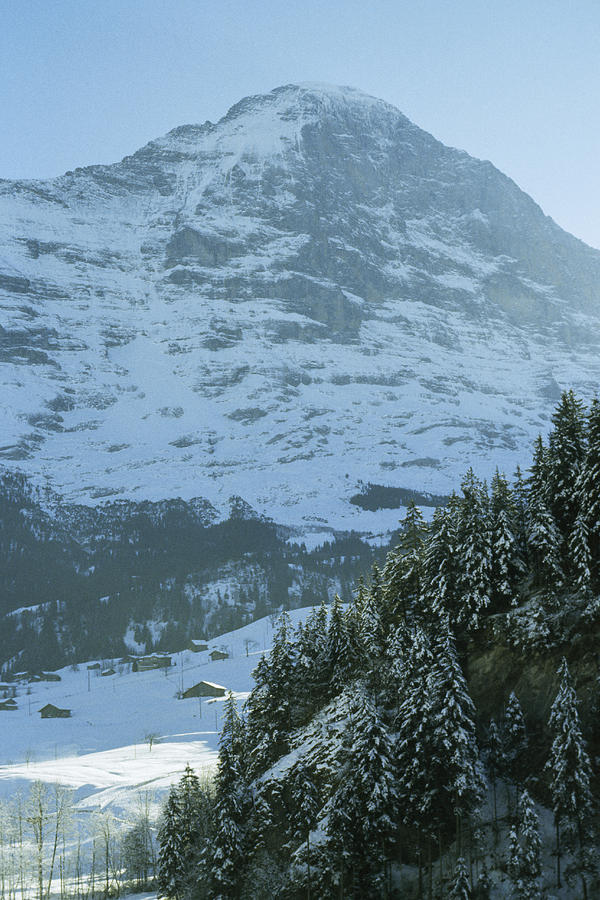 Swiss Alps Photograph - North Face Of The Eiger Towers by Gordon Wiltsie