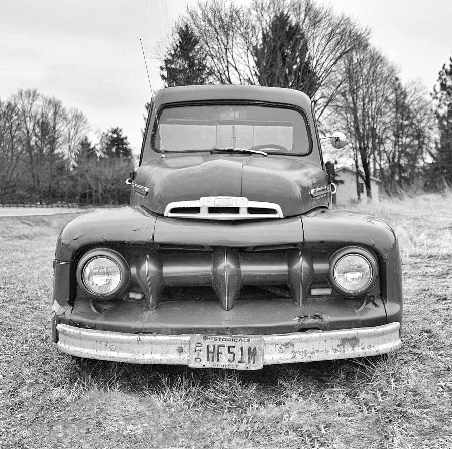 old ford truck in black and white photograph by brian