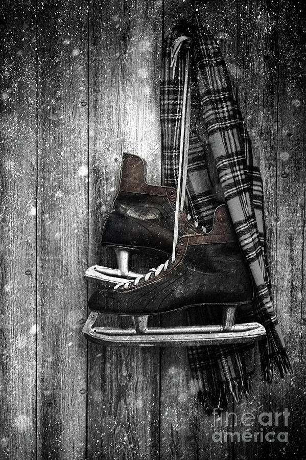 Atmosphere Photograph - Old Ice Skates Hanging On Barn Wall by Sandra Cunningham