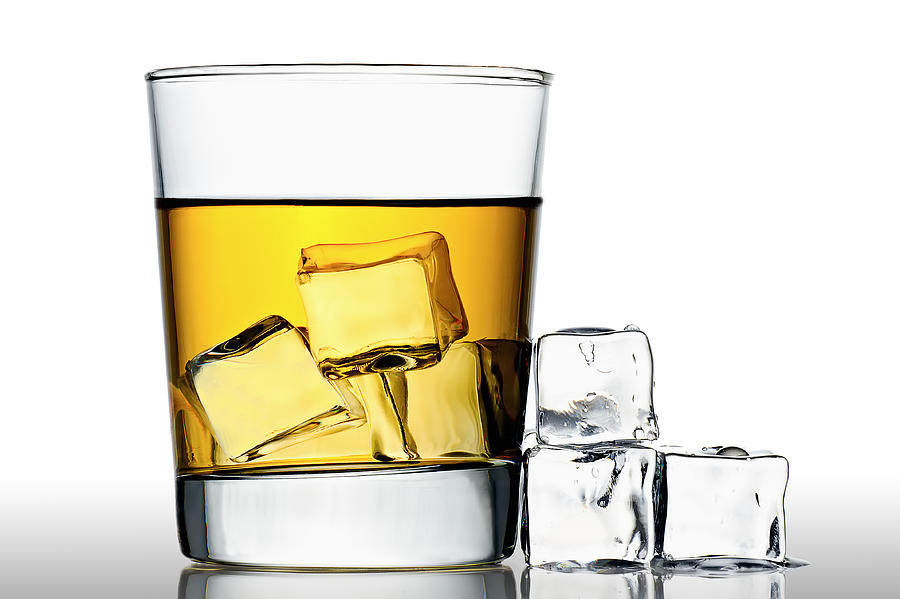 Alcohol Photograph - On The Rocks by Gert Lavsen