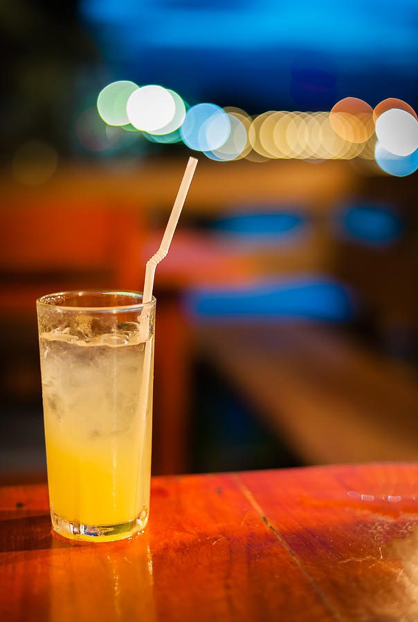 Beverage Photograph - Orange Juice On Table Wilth Color Of Light by Kittipan Boonsopit