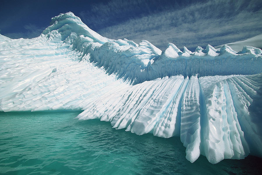 Hhh Photograph - Overturned Iceberg With Eroded Edges by Colin Monteath
