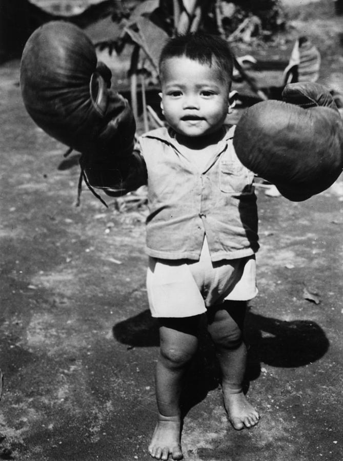 Child Photograph - Packing A Punch by Fox Photos