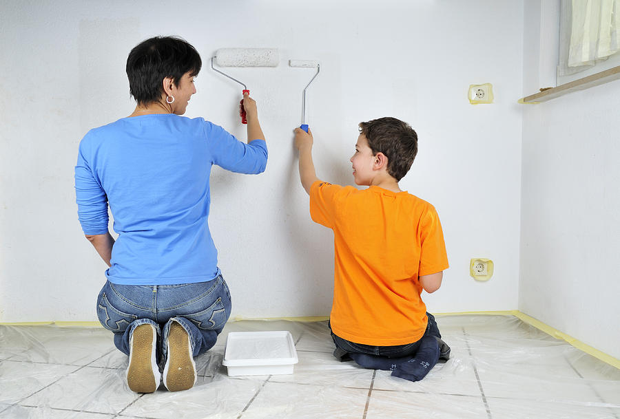 Teamwork Photograph - Paintwork - Mother And Son Painting Wall Together by Matthias Hauser